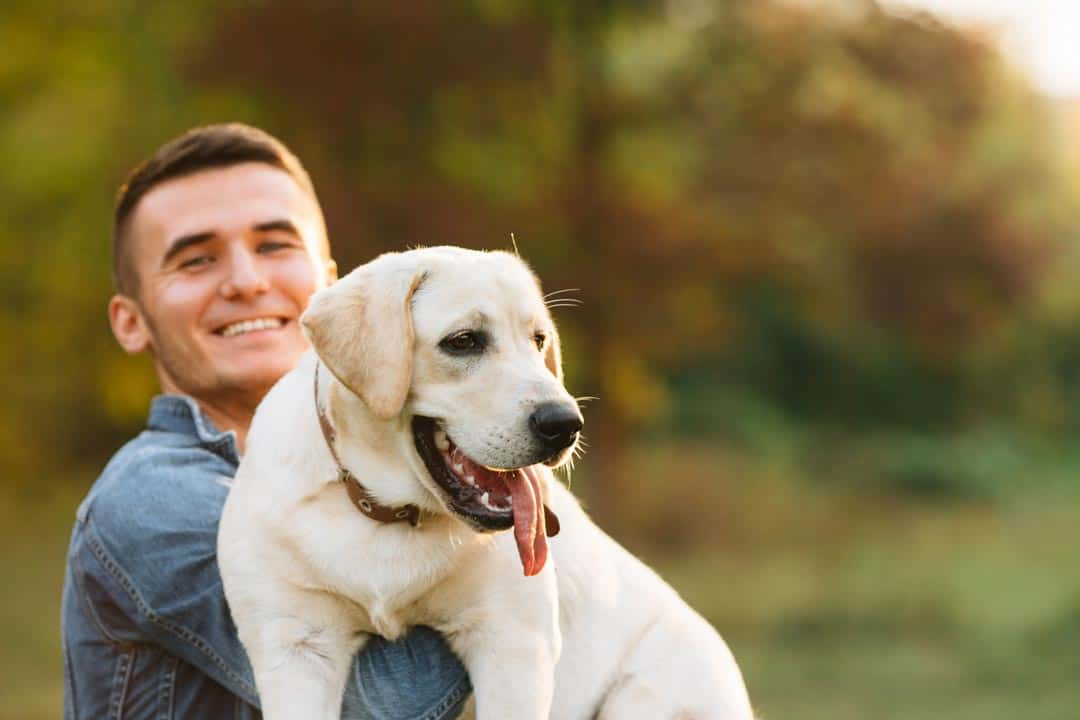 Man smiling with dog